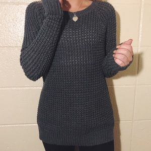 Grey crocheted long sweater.